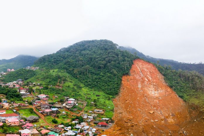 Photo: Luigi Torreggiani. A stitched panoramic drone image showing the aftermath of the mudslide in Sierra Leone that claimed more than 400 lives.